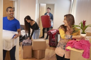 4 Students unpacking boxes in their new flat